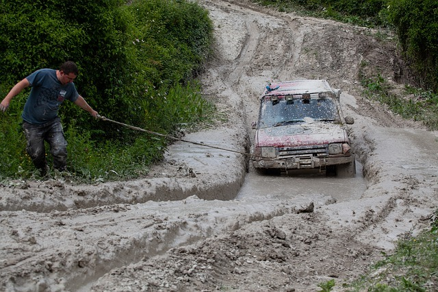 VEHICLE GETTING OUT OF MUD